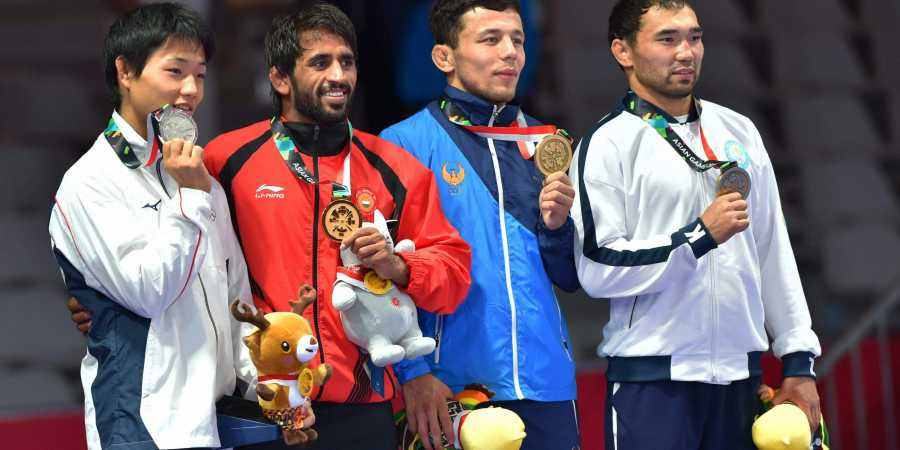Bajrang Punia wins gold, Shooters Apurvi Chandela, Ravi kumar clinch bronze